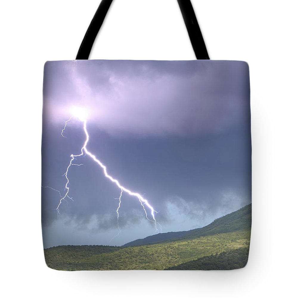 Photography Tote Bag featuring the photograph A Lightning Bolt From A Thunderstorm by Robbie George