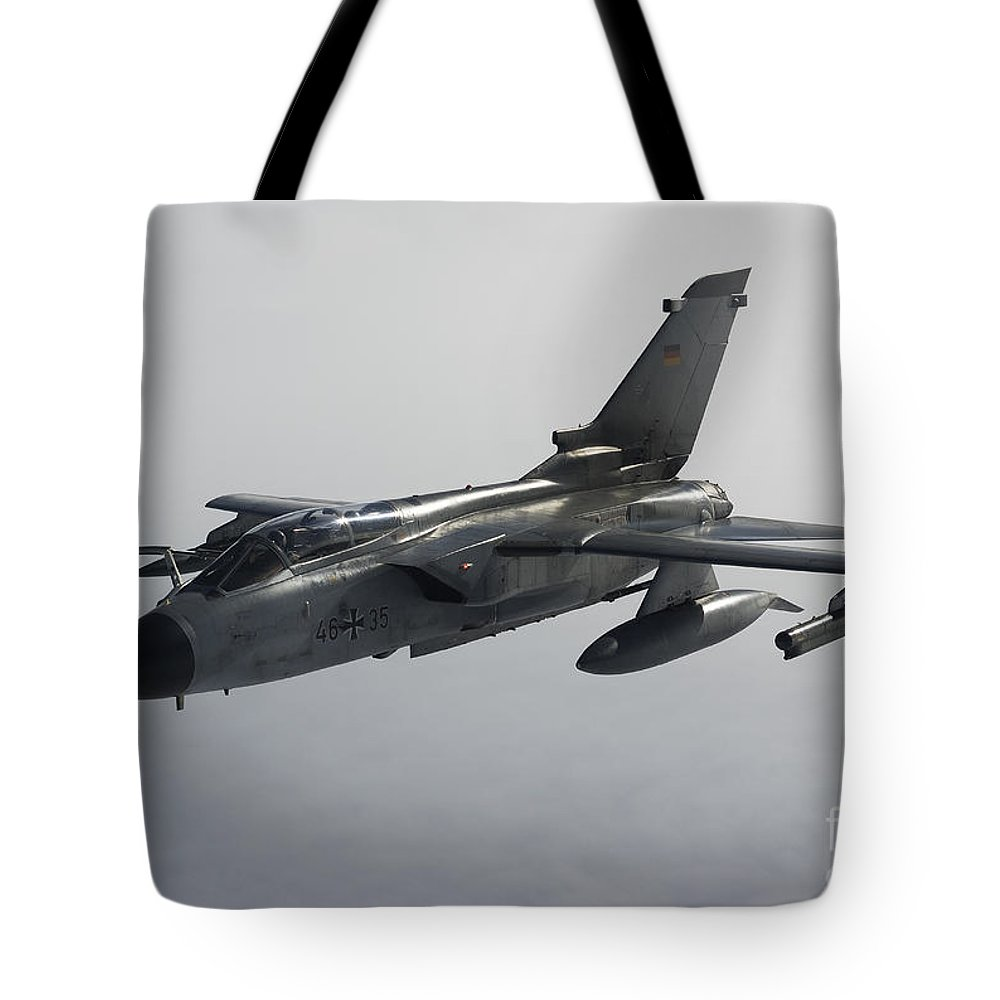 Germany Tote Bag featuring the photograph A Luftwaffe Tornado Ecr Over Northern by Gert Kromhout