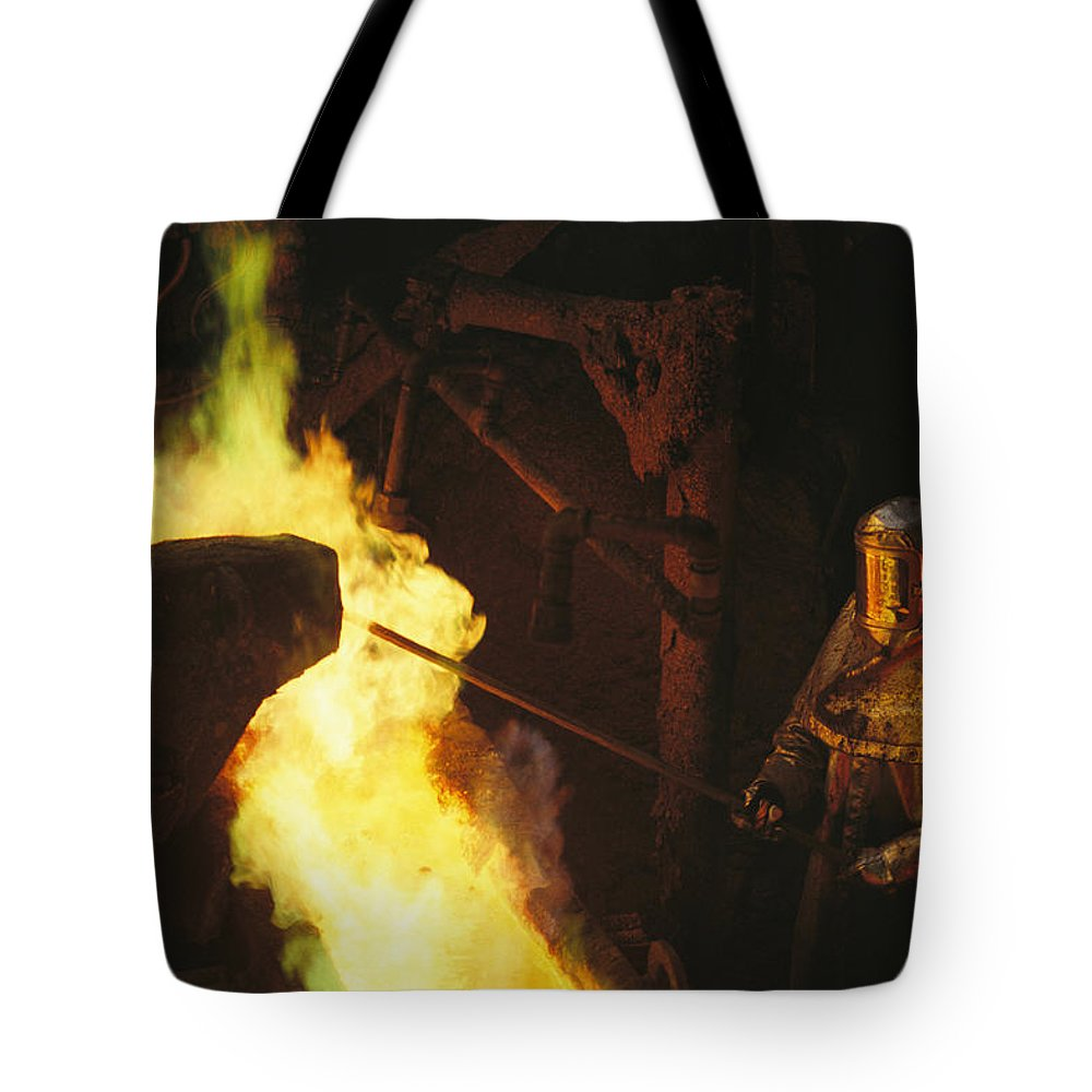 Subject Tote Bag featuring the photograph A Man In Protective Gear Tends by Joel Sartore