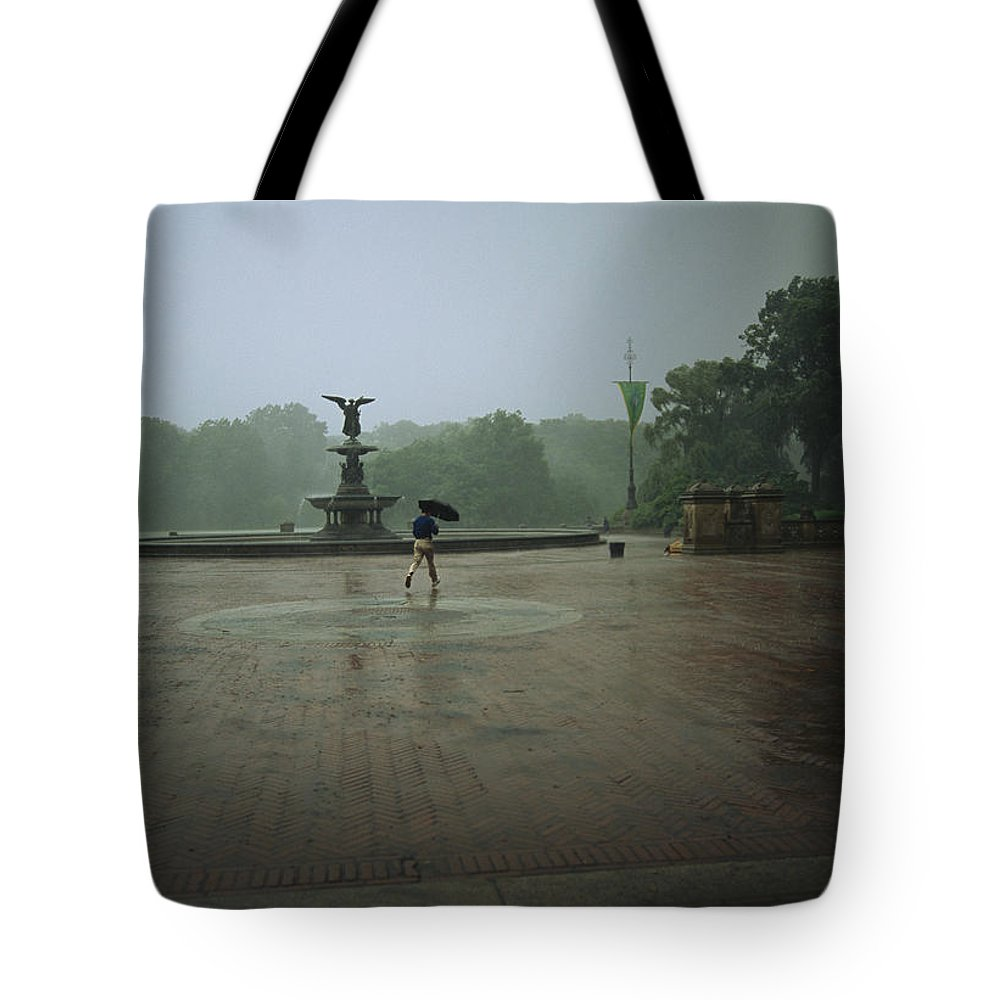 Angel Of The Waters Fountain Tote Bag featuring the photograph A Man Scurries Across Bethesda Terrace by Melissa Farlow