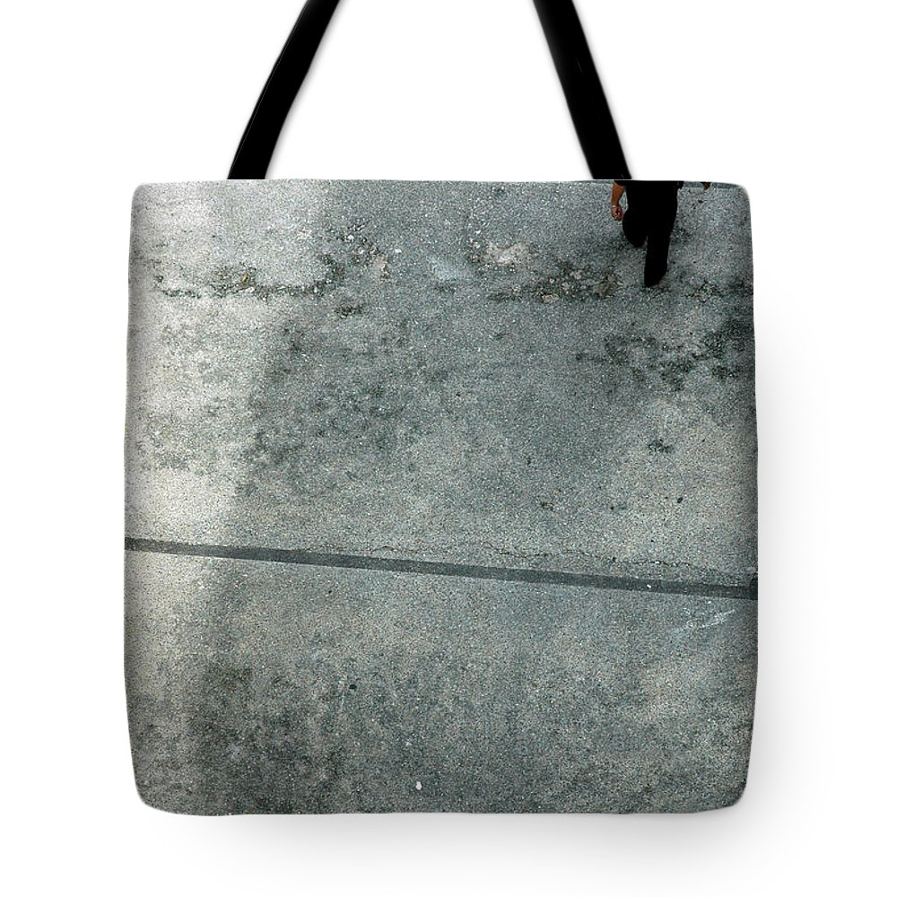 Walking Tote Bag featuring the photograph A Man Walked Visible From Above by Antoni Halim