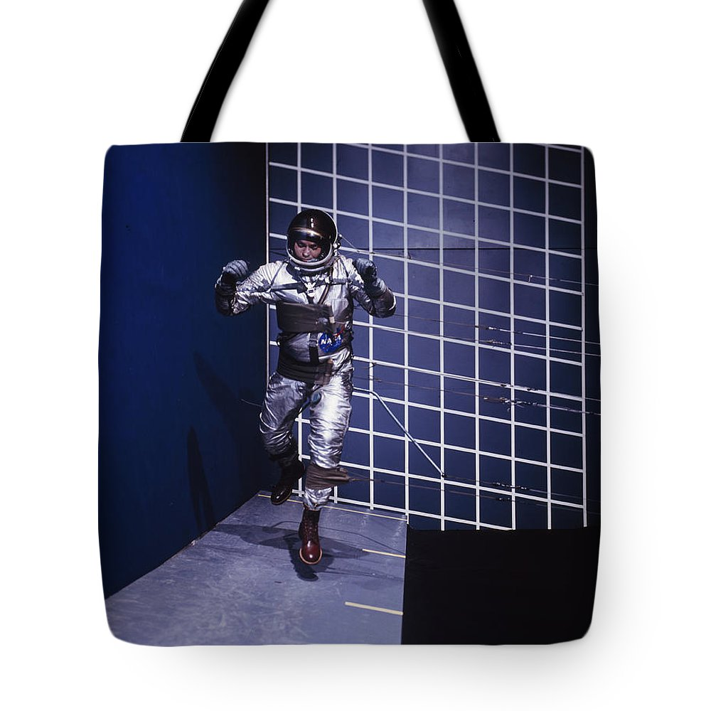 Day Tote Bag featuring the photograph A Man Walks A Wall In A Special Harness by Nasa