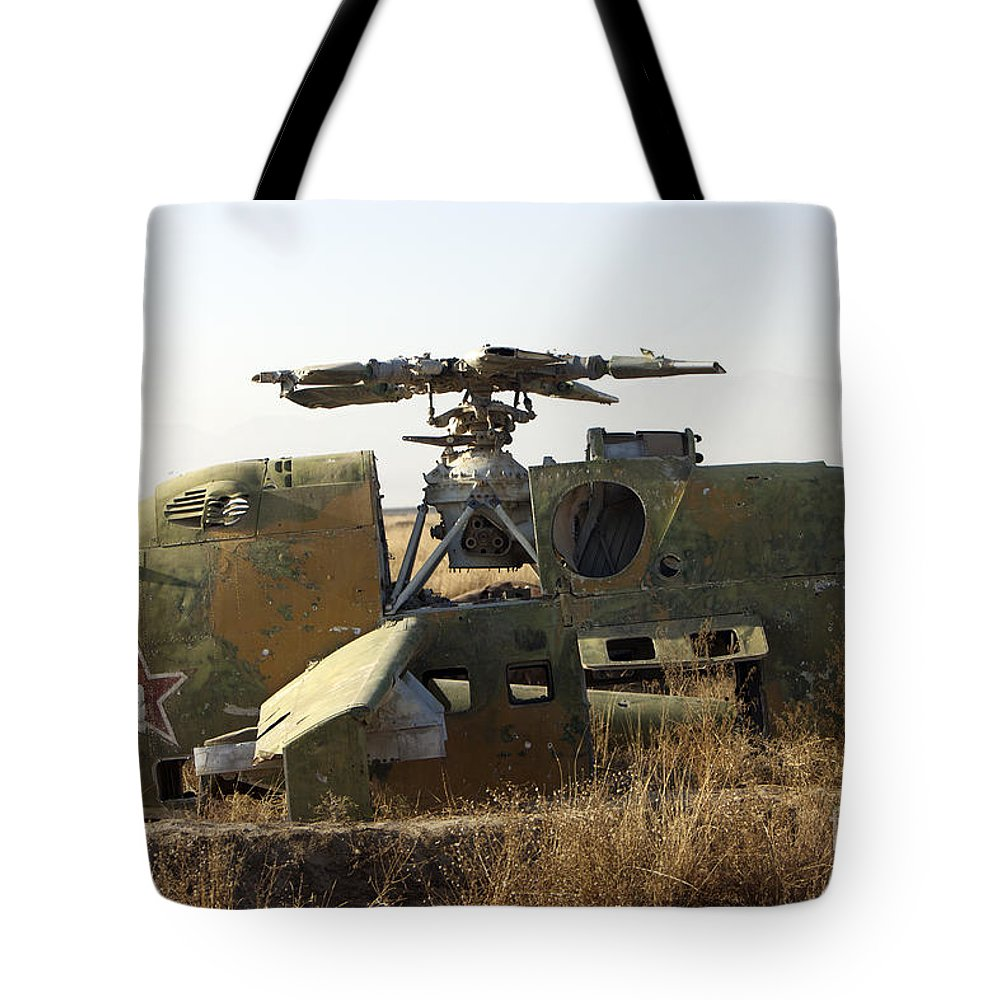 Russian Tote Bag featuring the photograph A Mi-35 Attack Helicopter At Kunduz Air by Terry Moore