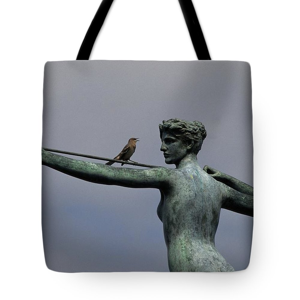 Brookgreen Gardens Tote Bag featuring the photograph A Mockingbird Sits Atop A Bronze by Raymond Gehman