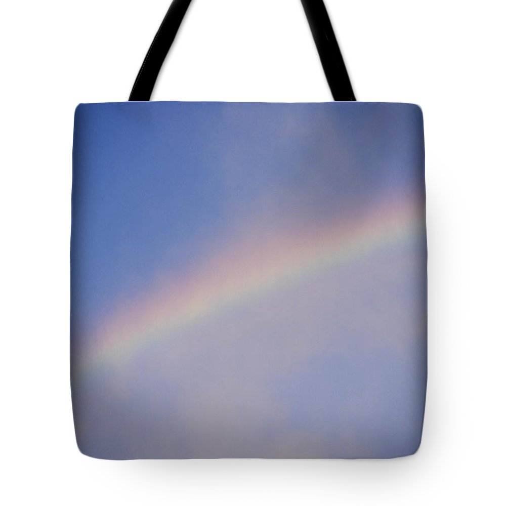 Natural Forces And Phenomena Tote Bag featuring the photograph A Rainbow Arcs Across The Sky by Joel Sartore