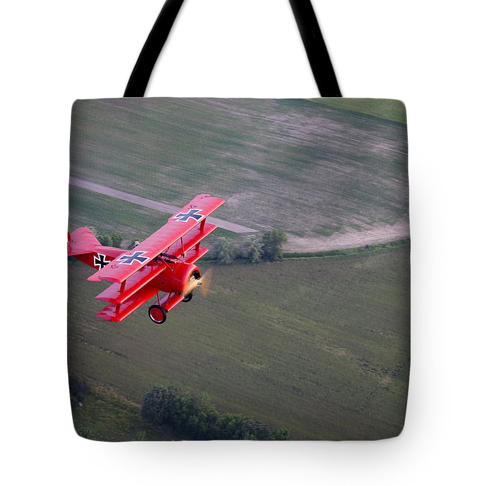 Day Tote Bag featuring the photograph A Replica Fokker Dr. I, A Red Triplane by Pete Ryan