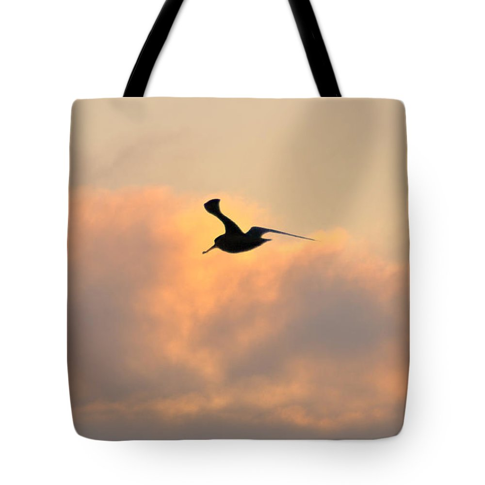 Seagull Tote Bag featuring the photograph A Seagull Takes Flight by Bill Cannon
