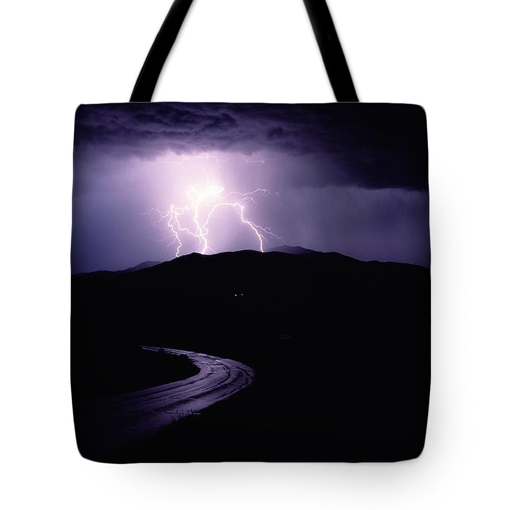Yellowstone National Park Tote Bag featuring the photograph A Summer Storm In Yellowstone National by Raymond Gehman