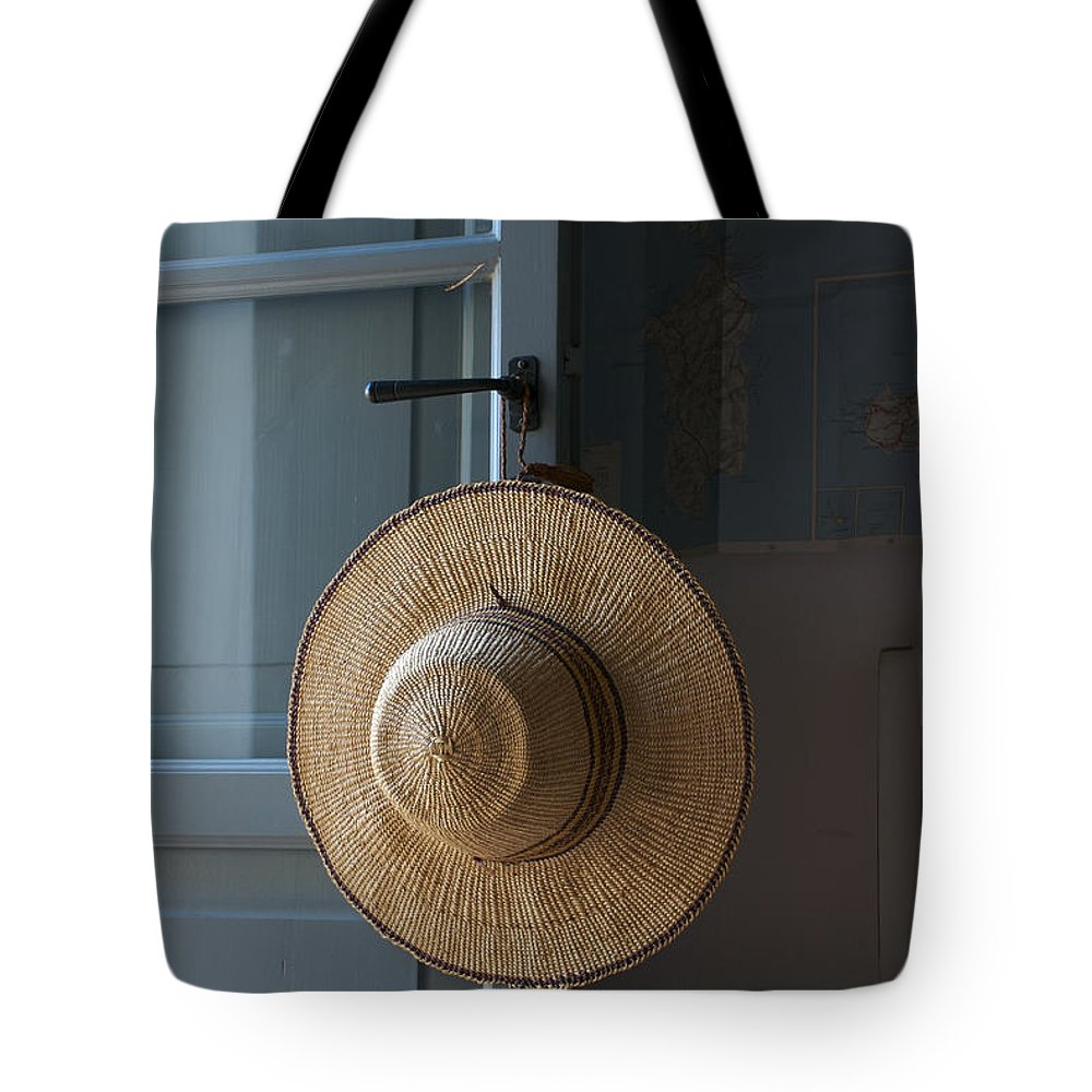 Indoors Tote Bag featuring the photograph A Sun Hat Hangs On The Door Of A Tuscan by Heather Perry