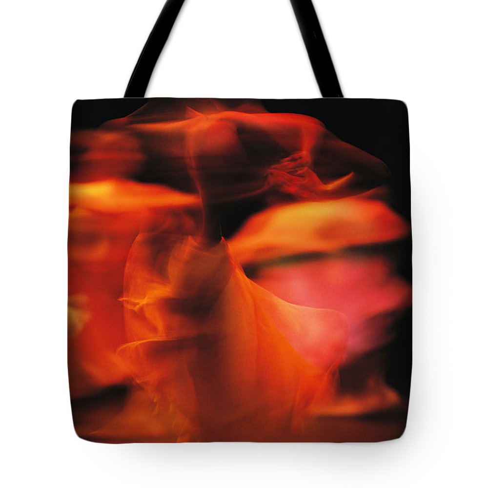 Africa Tote Bag featuring the photograph A Time-exposed View Of A Performance by Michael Nichols