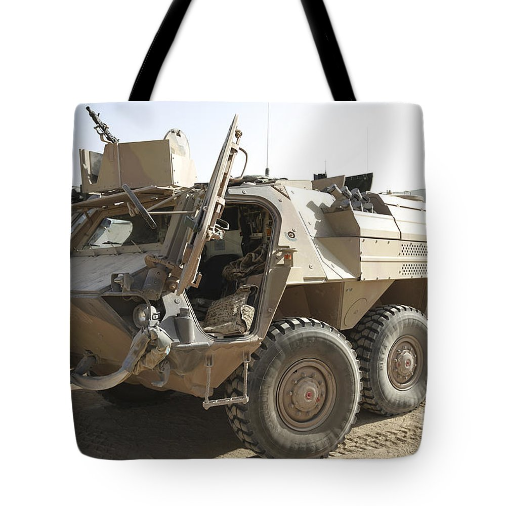 Isaf Tote Bag featuring the photograph A Tpz Fuchs Armored Personnel Carrier by Terry Moore