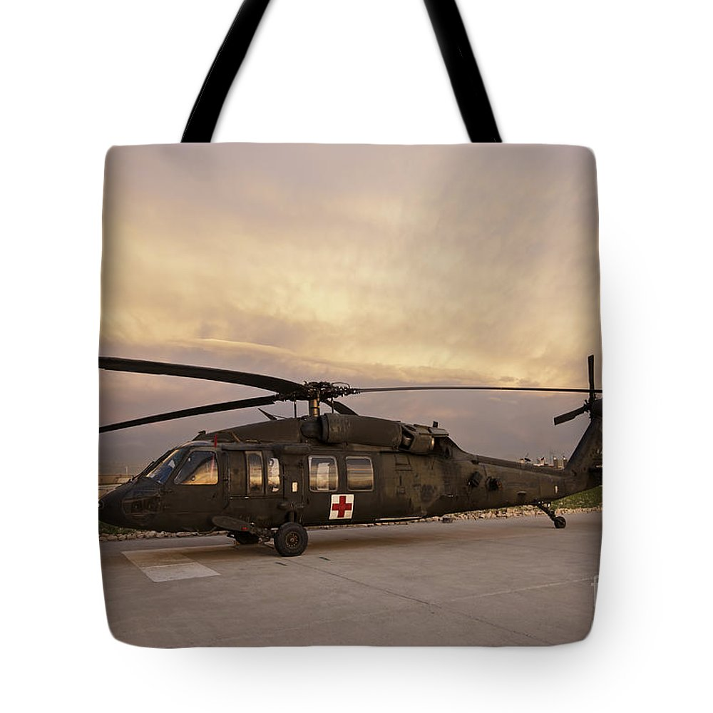 Blackhawk Tote Bag featuring the photograph A Uh-60l Black Hawk Medevac Helicopter by Terry Moore