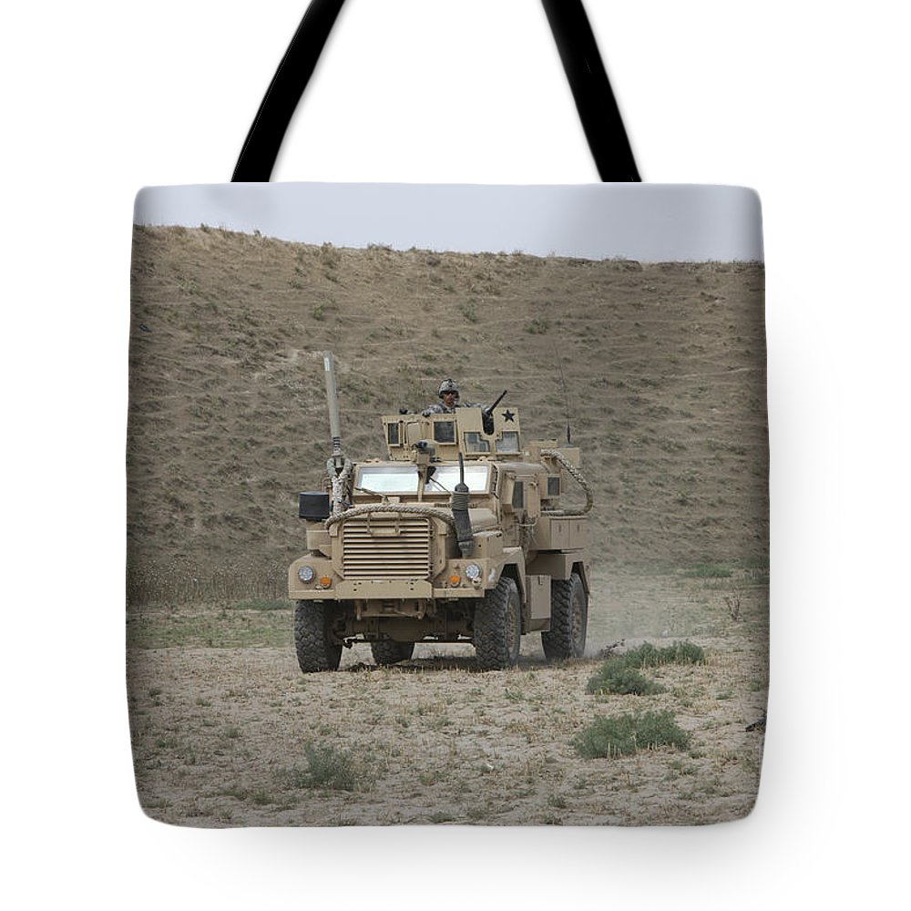 Mrap Tote Bag featuring the photograph A U.s. Army Cougar Patrols A Wadi by Terry Moore