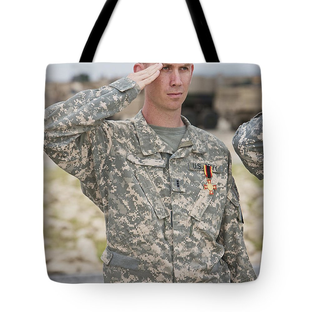 Standing Tote Bag featuring the photograph A U.s Army Soldier And Recipient by Terry Moore