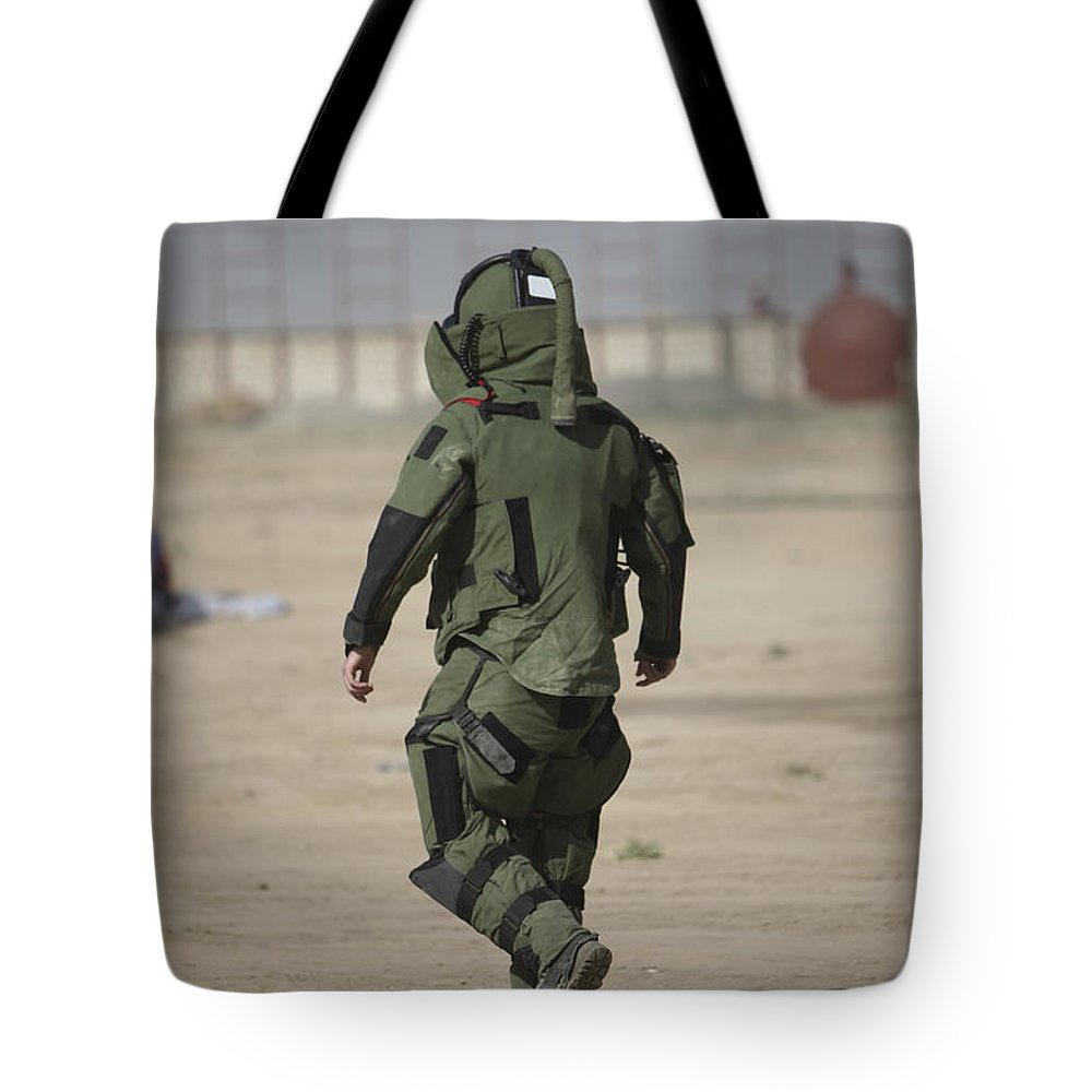 Kunduz Tote Bag featuring the photograph A U.s. Marine Tries Running In A Bomb by Terry Moore