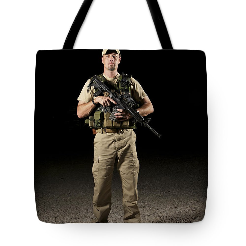 Equipment Tote Bag featuring the photograph A U.s. Police Officer Contractor by Terry Moore