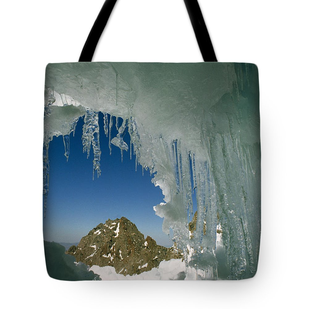 Color Image Tote Bag featuring the photograph A View Of A Mountain Summit by Gordon Wiltsie