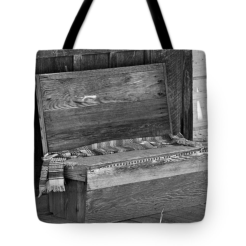 Bench Tote Bag featuring the photograph A Weathered Bench Black And White by Phyllis Denton