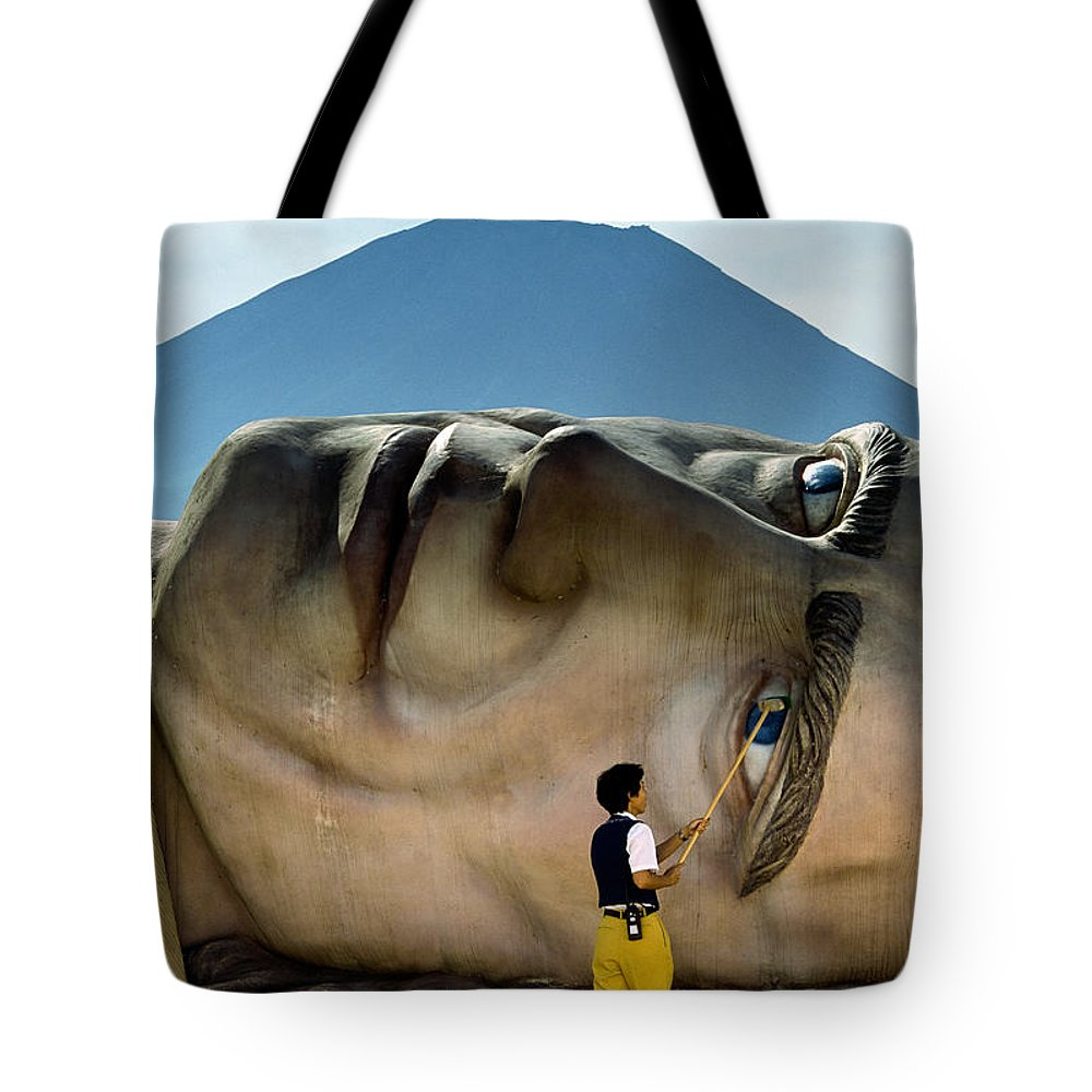 Asia Tote Bag featuring the photograph A Worker At The Defunct Gullivers by Karen Kasmauski