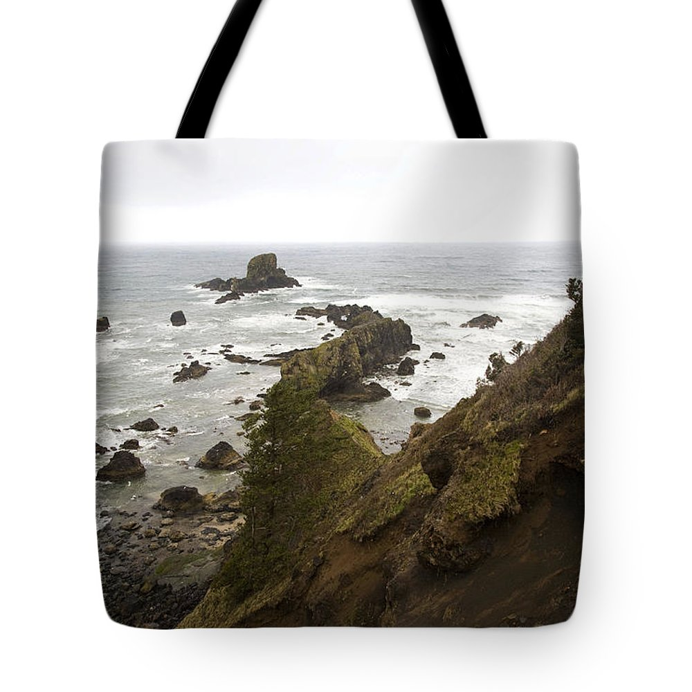 Oregon Tote Bag featuring the photograph A Young Man Wearing A Yellow Jacket by Michael Hanson