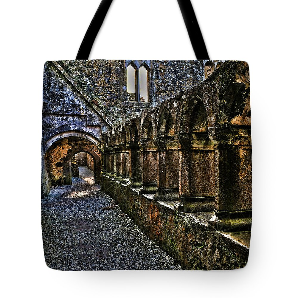 Ireland Tote Bag featuring the photograph Abbey Corridor by Linda Clifford