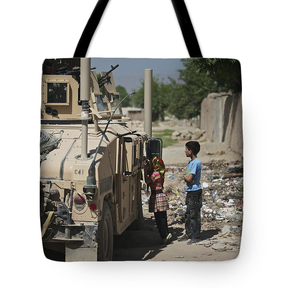 Us Army Tote Bag featuring the photograph Afghan Children Ask U.s. Soldiers by Terry Moore