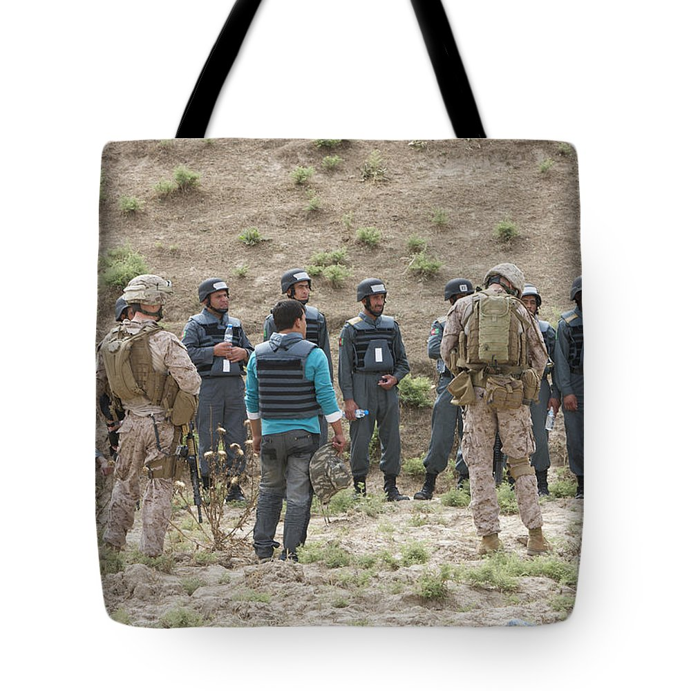 Us Marines Tote Bag featuring the photograph Afghan Police Students Listen To U.s by Terry Moore