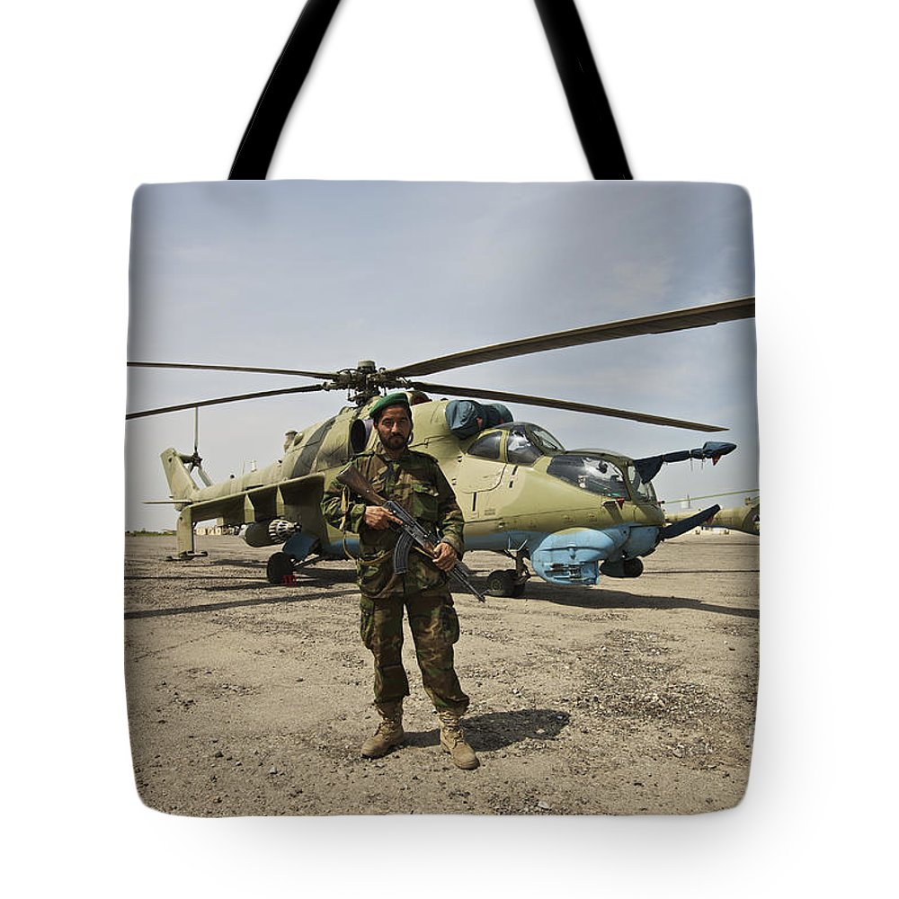 Attack Helicopters Tote Bag featuring the photograph An Afghan Army Soldier Guards A Couple by Terry Moore