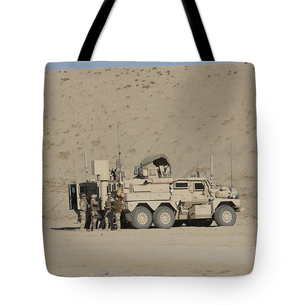 Explosive Ordnance Disposal Tote Bag featuring the photograph An Eod Cougar Mrap In A Wadi by Terry Moore