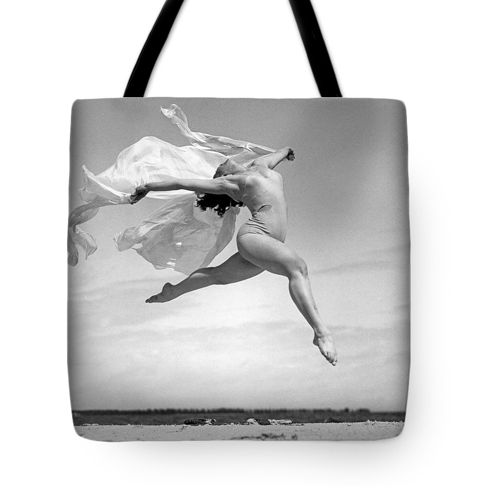 1035-751 Tote Bag featuring the photograph An Exuberant Dance To Spring by Underwood Archives