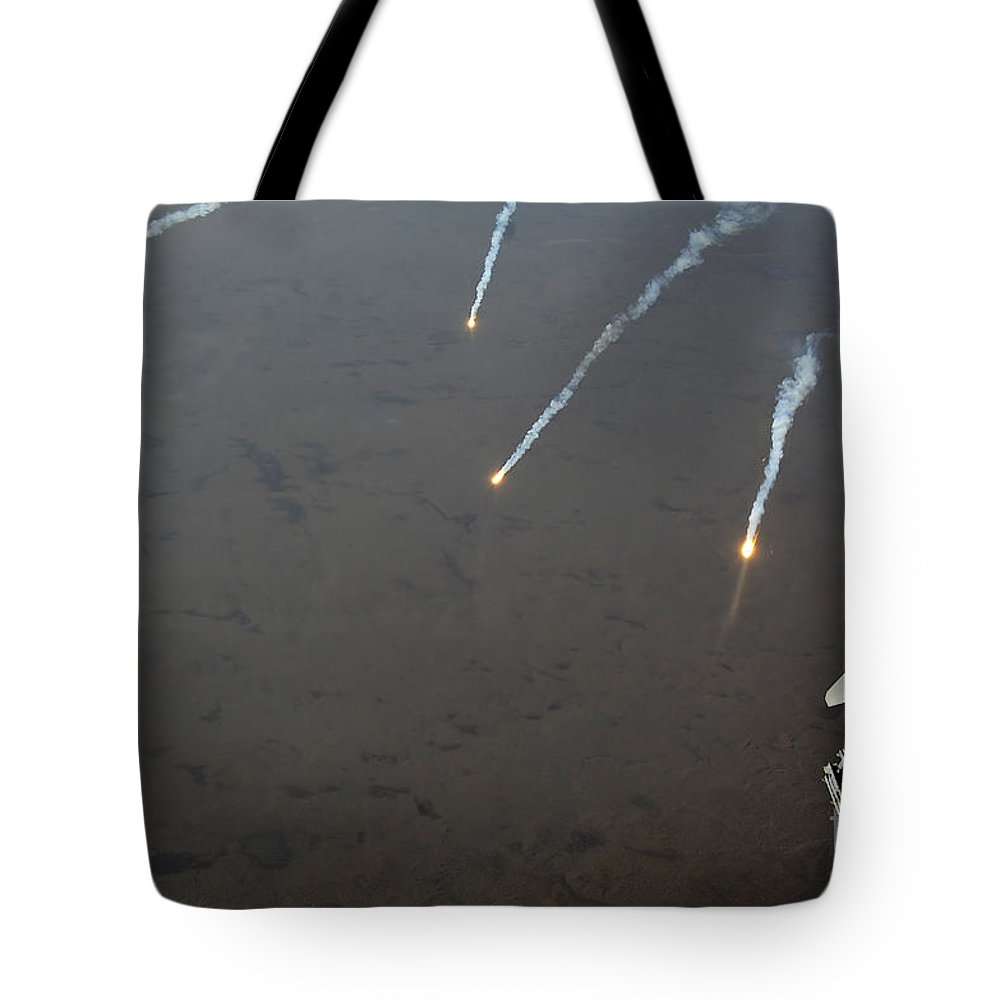 Turning Tote Bag featuring the photograph An F-16 Fighting Falcon Jet Pitches by Stocktrek Images