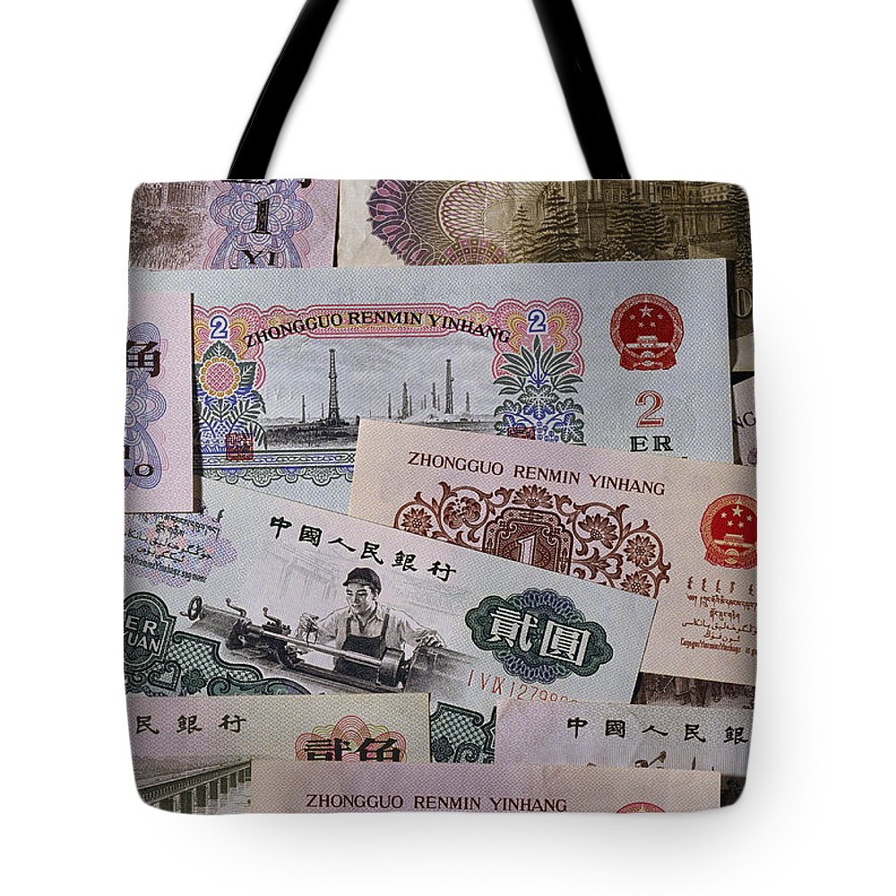 Studio Shot Tote Bag featuring the photograph An Image Of Chinas Colorful Paper Money by Todd Gipstein