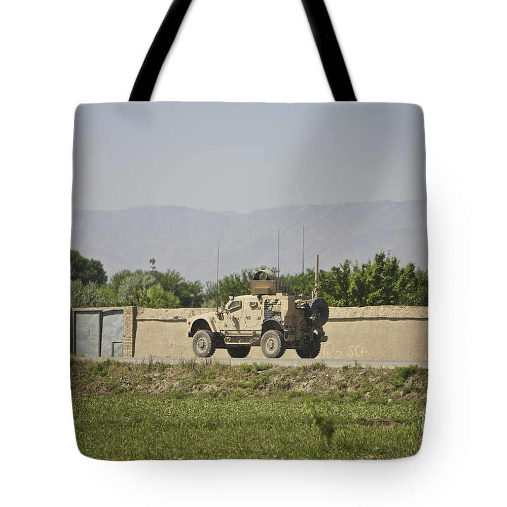 Afghanistan Tote Bag featuring the photograph An M-atv Driving Towards Aliabad by Terry Moore