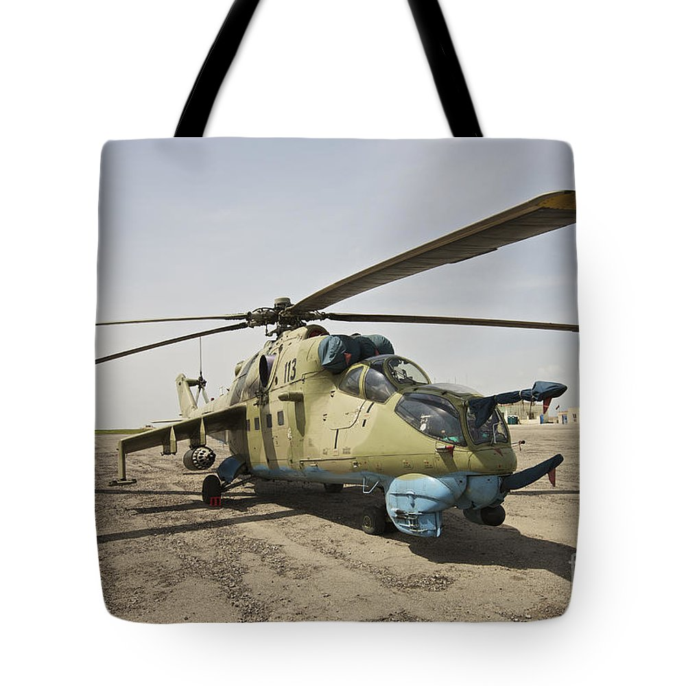 Camouflage Tote Bag featuring the photograph An Mi-35 Attack Helicopter At Kunduz by Terry Moore