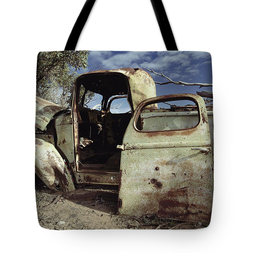 Subject Tote Bag featuring the photograph An Old Wrecked Truck In A Desert by Jason Edwards