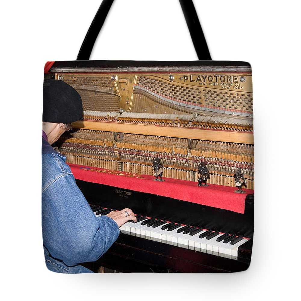 Man Playing 1909 Playtone Piano Converted From Player Style Tote Bag featuring the photograph Antique Playtone Piano by Sally Weigand