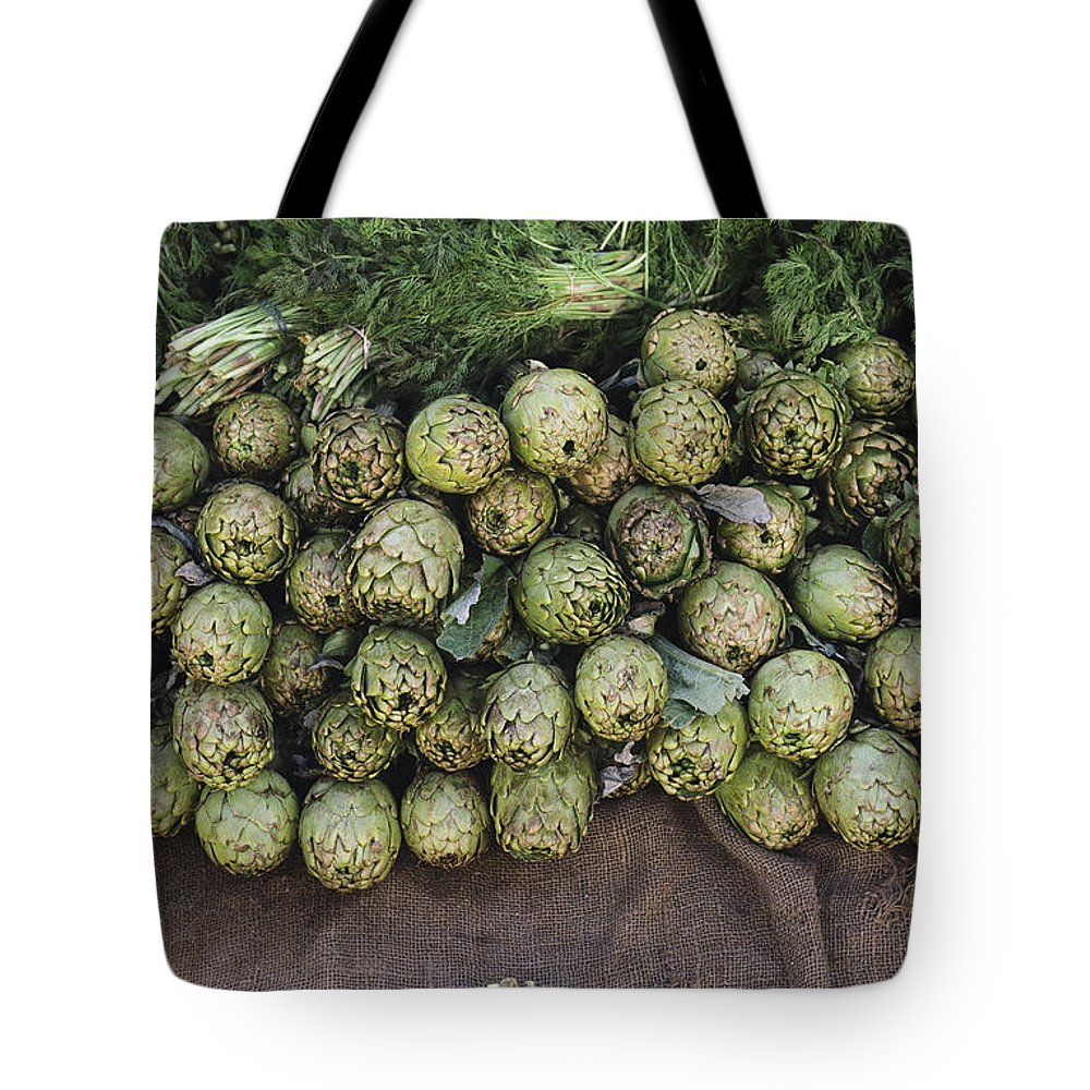 United States Of America Tote Bag featuring the photograph Artichokes And Greens Arranged by Bill Curtsinger