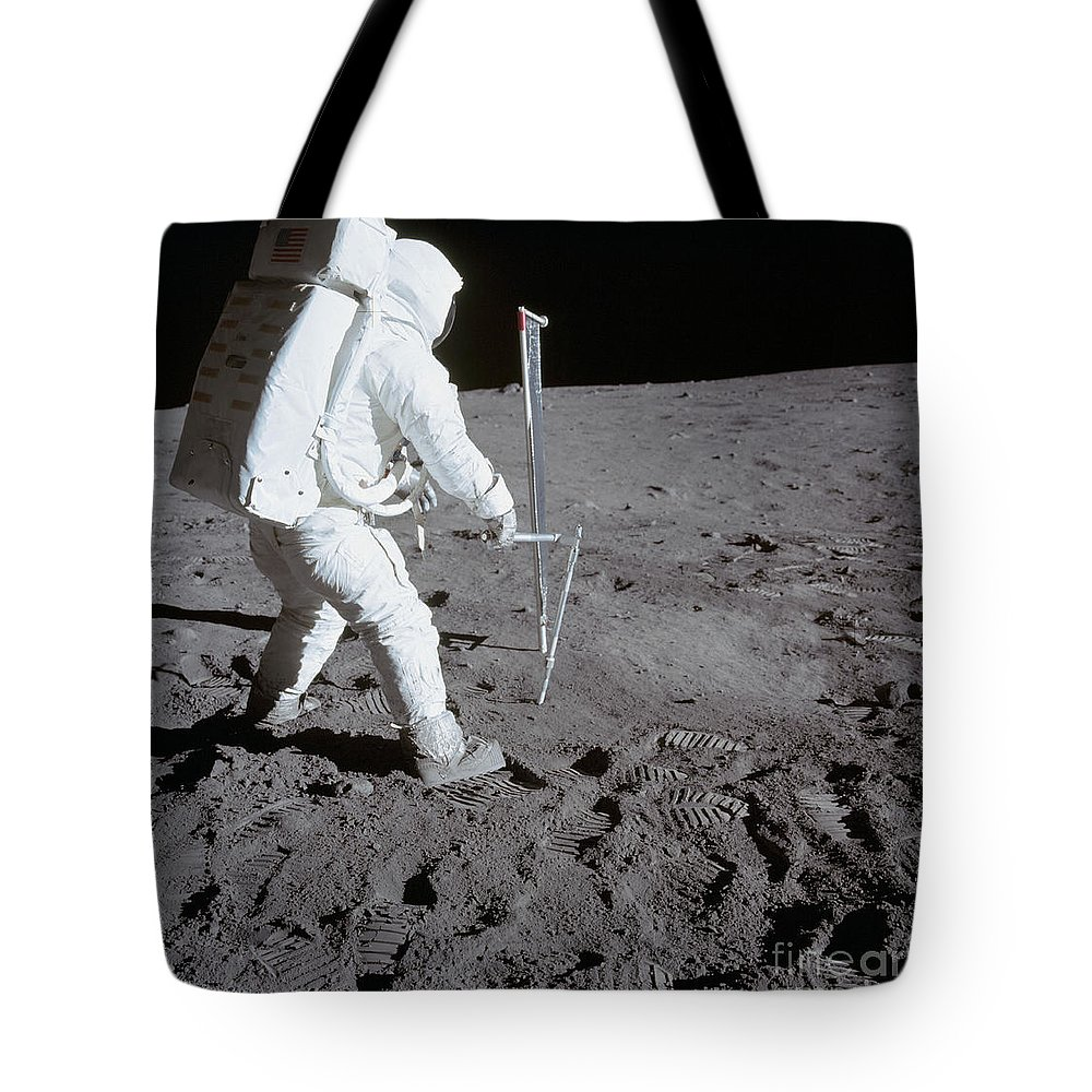 1969 Tote Bag featuring the photograph Astronaut During Apollo 11 by Stocktrek Images
