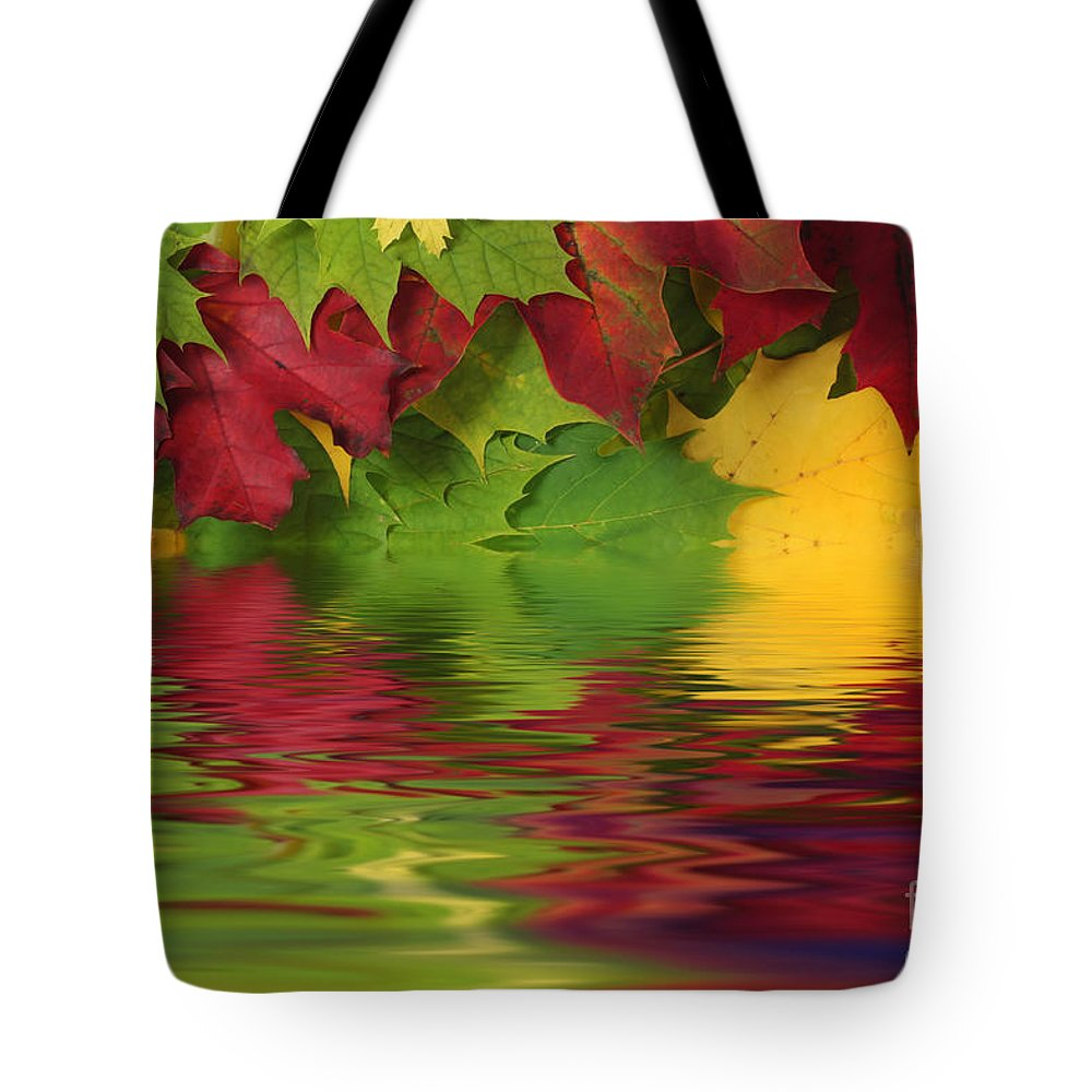 Leaves Tote Bag featuring the photograph Autumn Leaves In Water With Reflection by Simon Bratt Photography LRPS