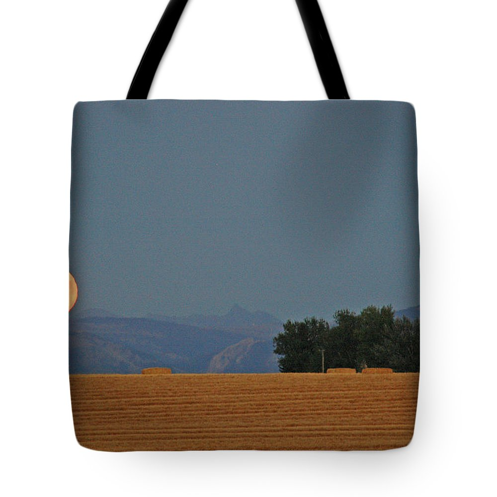 Moon Tote Bag featuring the photograph Autumn Moonrise Over Montana's Bridger Mountains by Bruce Gourley