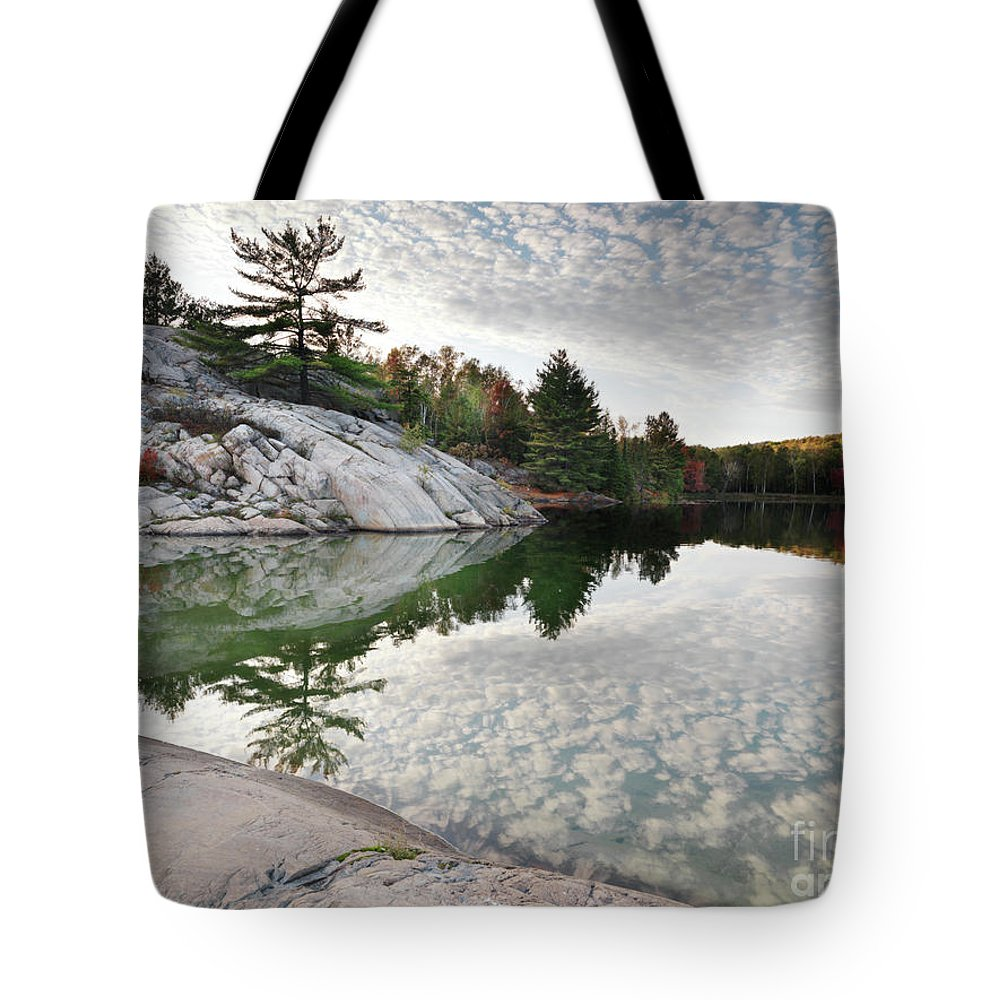 Lake Tote Bag featuring the photograph Autumn Nature Lake Rocks And Trees by Oleksiy Maksymenko