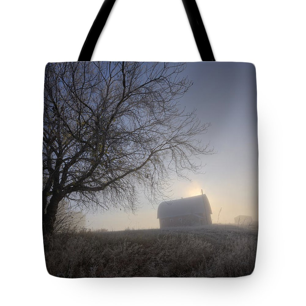 Agriculture Tote Bag featuring the photograph Autumn Sunrise Over Barn On A Farm by Dan Jurak