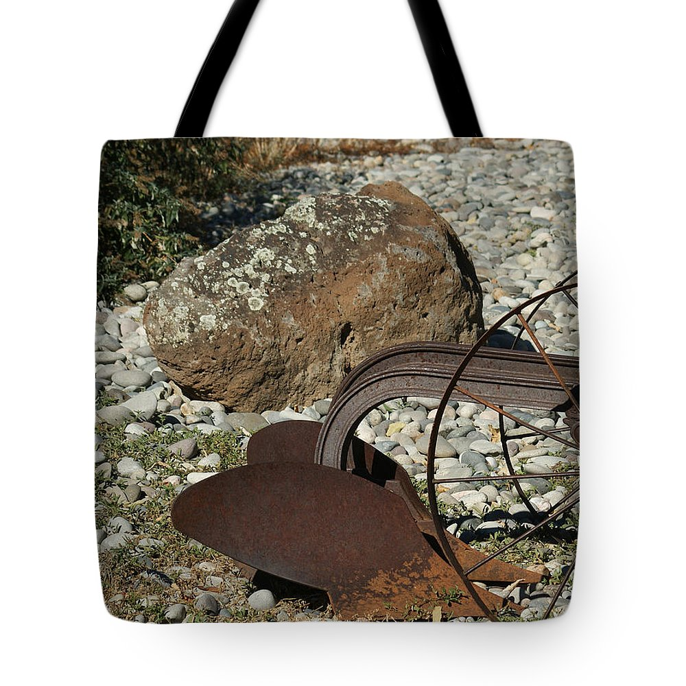 Plow Tote Bag featuring the photograph Back Half Of Old Plow by Ernie Echols