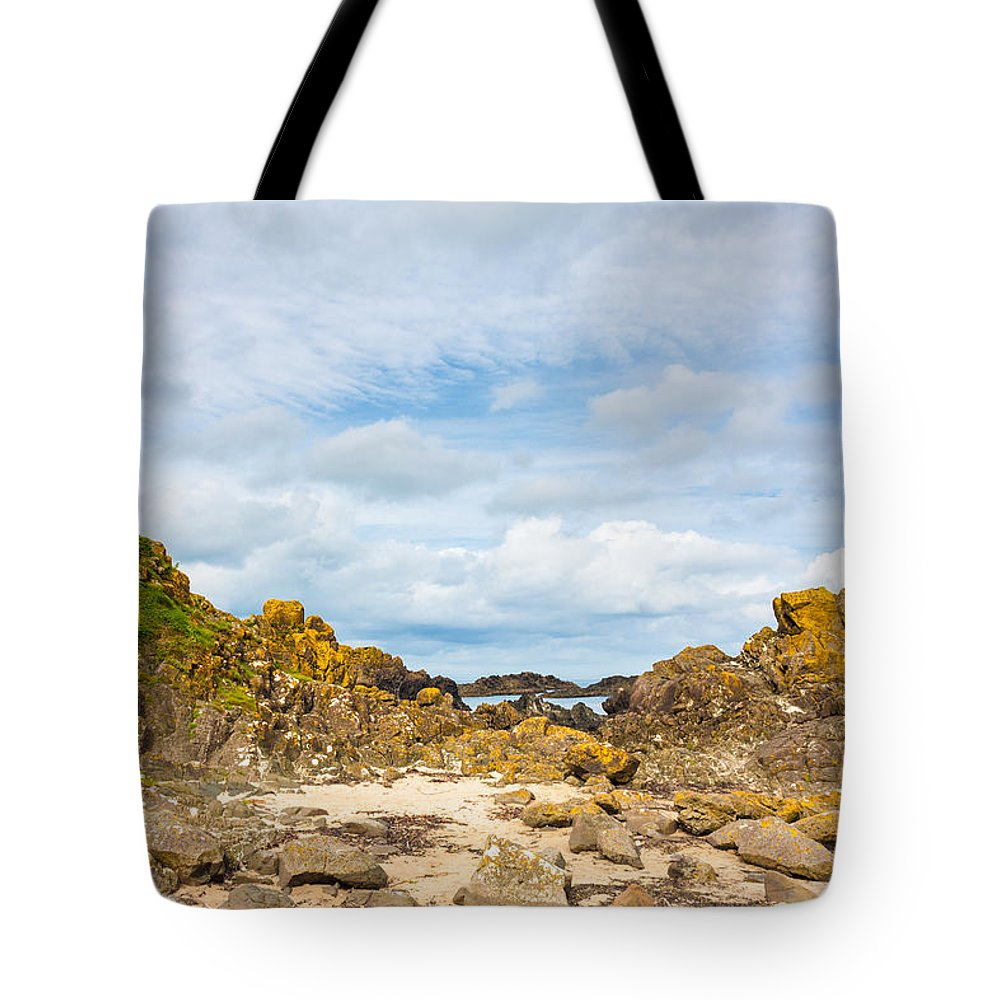 Black Tote Bag featuring the photograph Ballintoy Bay Basalt Rock by Semmick Photo