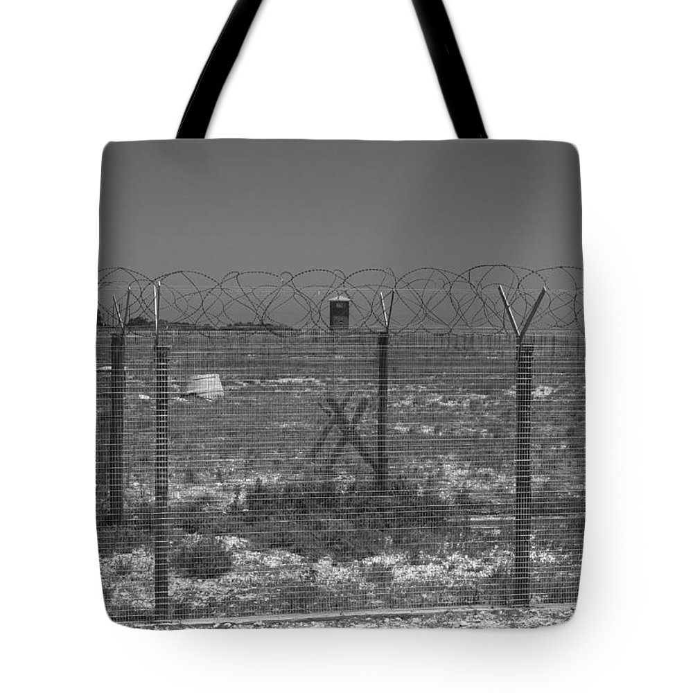 Robben Island Tote Bag featuring the photograph Barbed Wire Fence by Aidan Moran