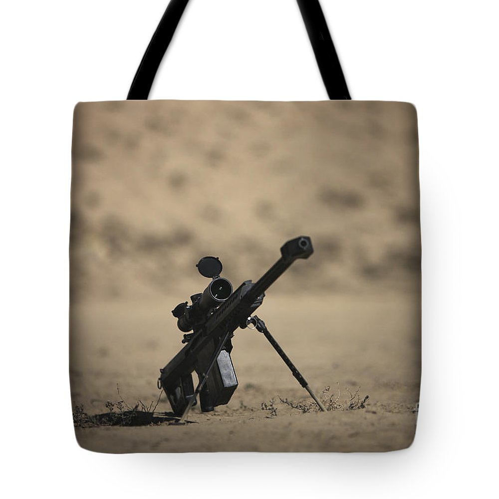 Kunduz Tote Bag featuring the photograph Barrett M82a1 Rifle Sits Ready by Terry Moore