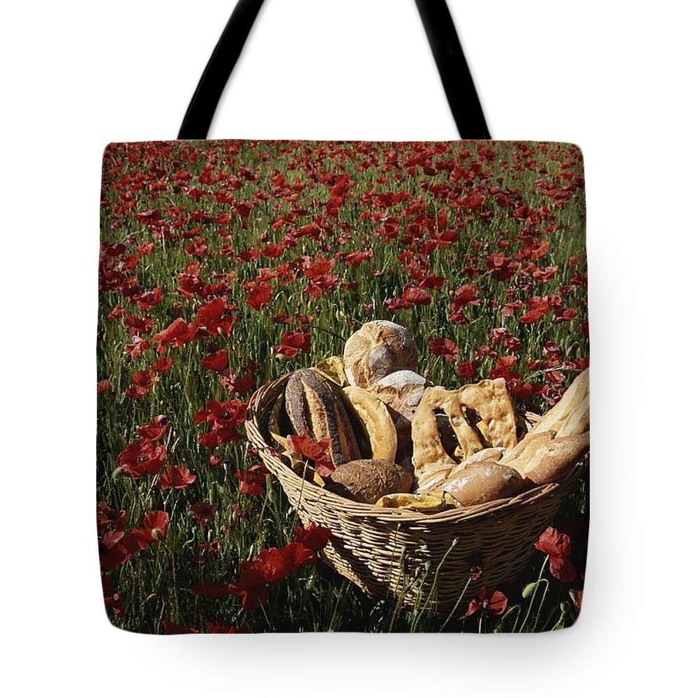 Europe Tote Bag featuring the photograph Basket Of Bread In A Poppy Field by Nicole Duplaix