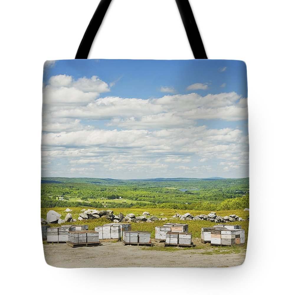Beehive Tote Bag featuring the photograph Beehives In A Maine Blueberry Field by Keith Webber Jr