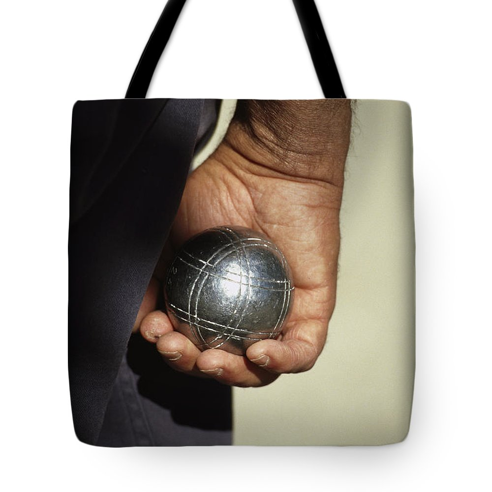 Anatomy Tote Bag featuring the photograph Bocce Bowler Holding A Ball by Nicole Duplaix