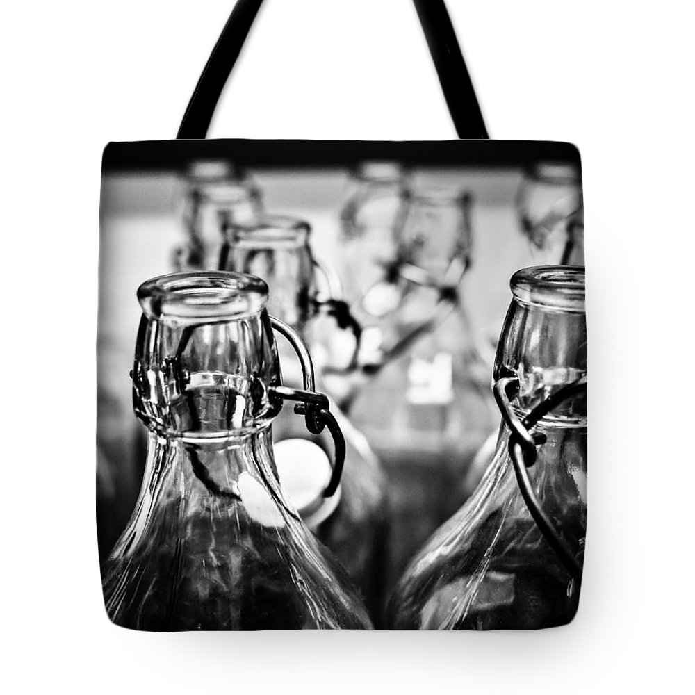 Bottles Tote Bag featuring the photograph Bottles by Hakon Soreide